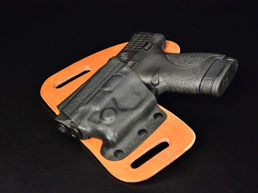 Smith & Wesson Shield with Viridian Green Laserguard