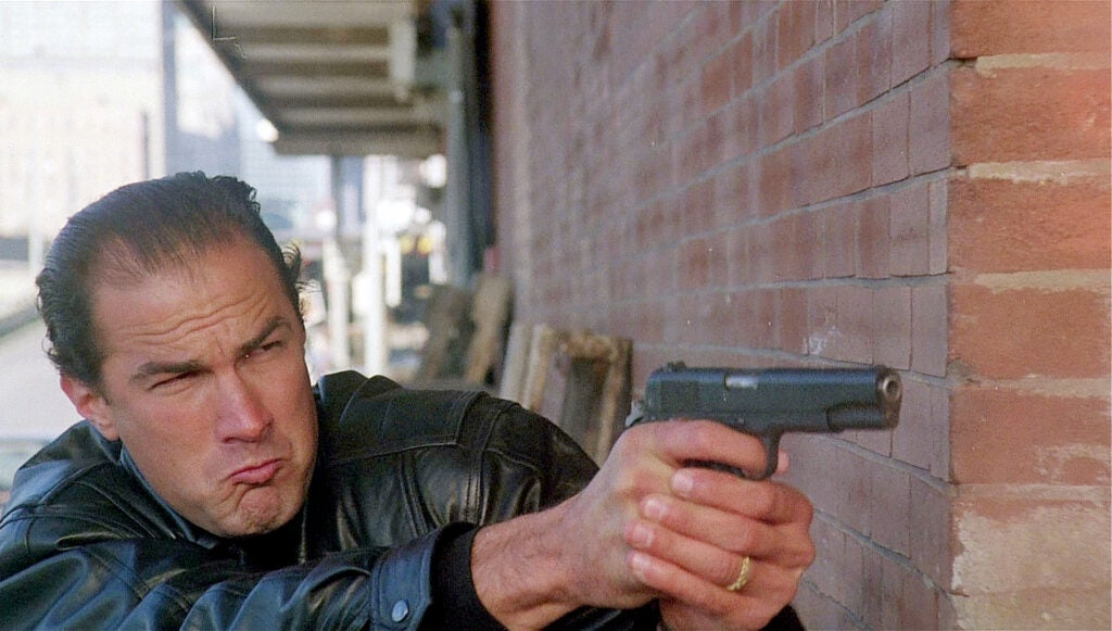 seagal carrying colt government m1911a1 pistol