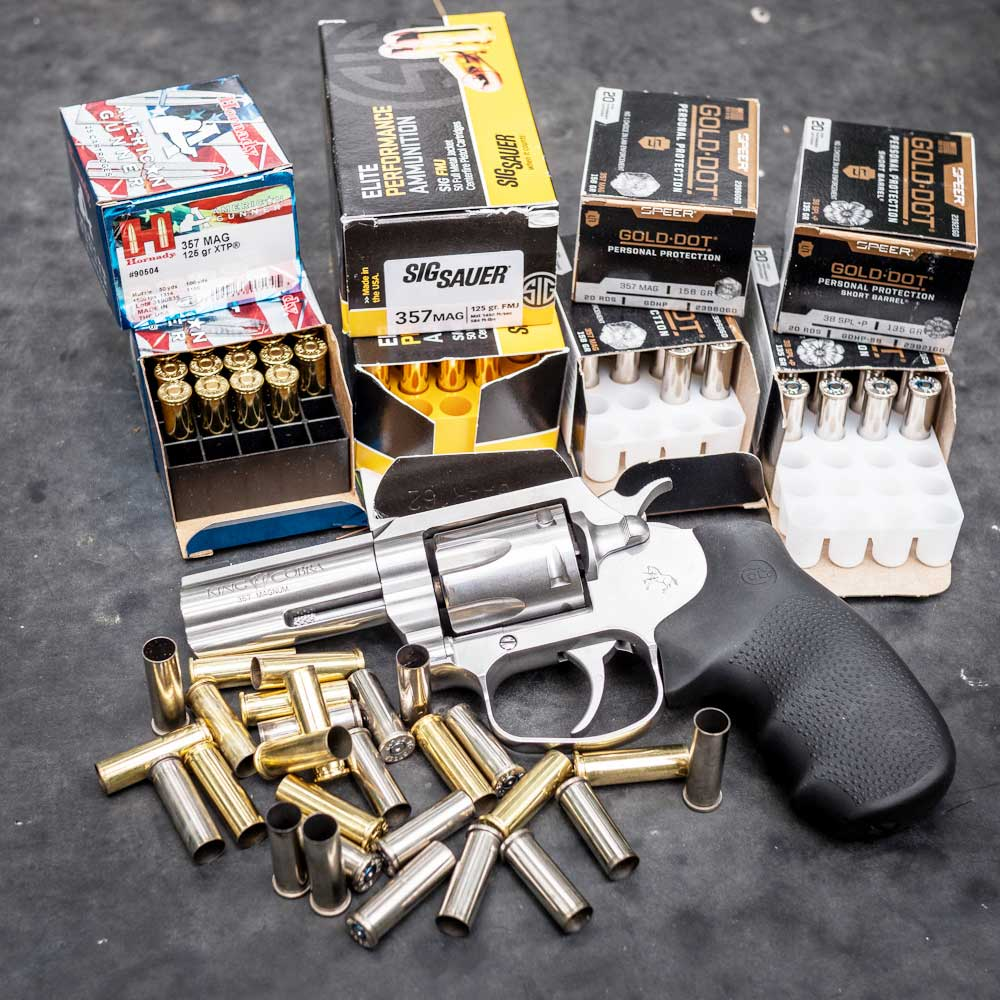 a colt king cobra and boxes of handgun ammo
