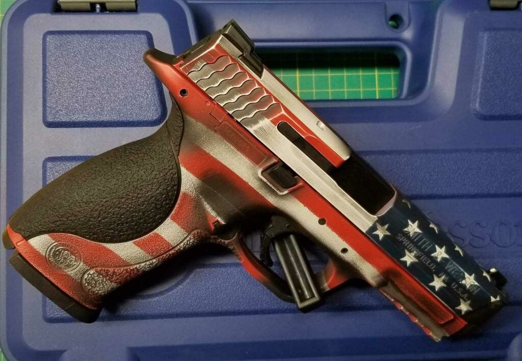a handgun painted with an American flag pattern