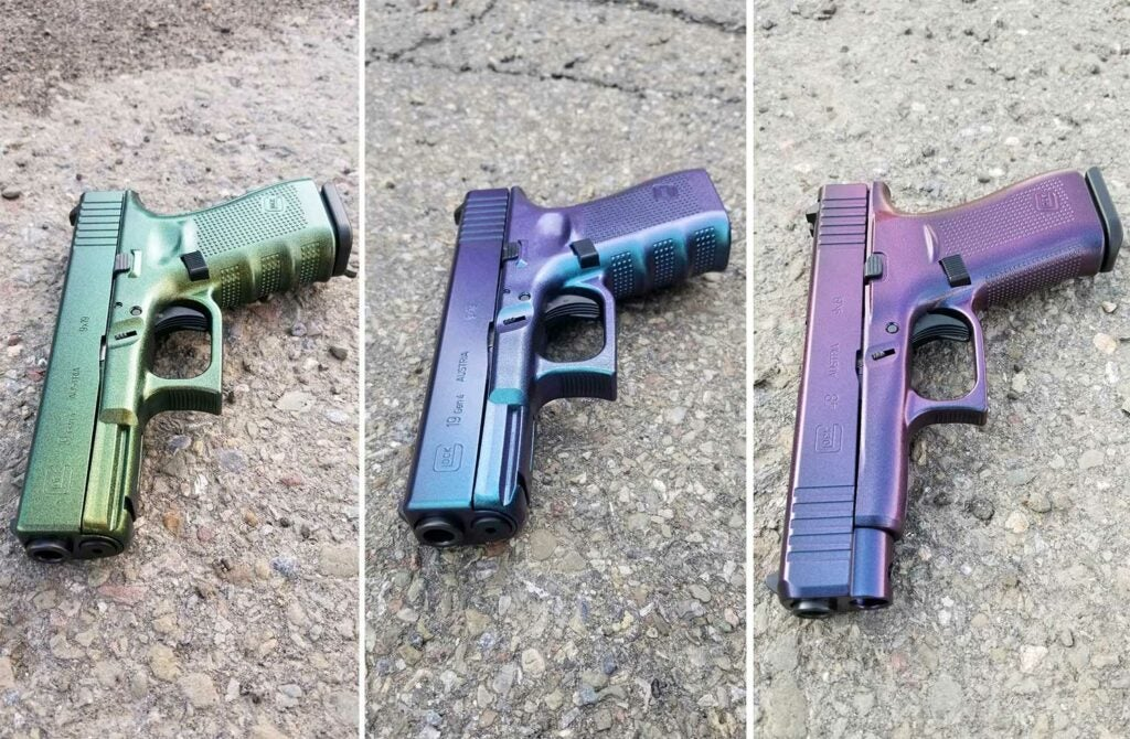 three custom-painted gradient cerakoted handguns