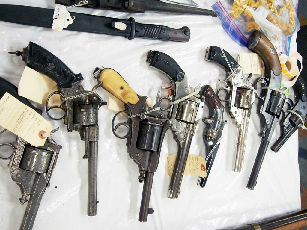a lineup of 19th century european pistols