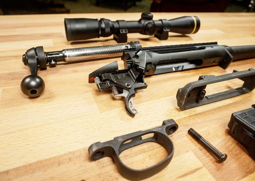 disassembled parts of Savage Arms 220 rifle