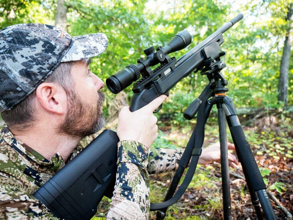 Michael R. Shea scans for squirrels with the Summit at the ready.