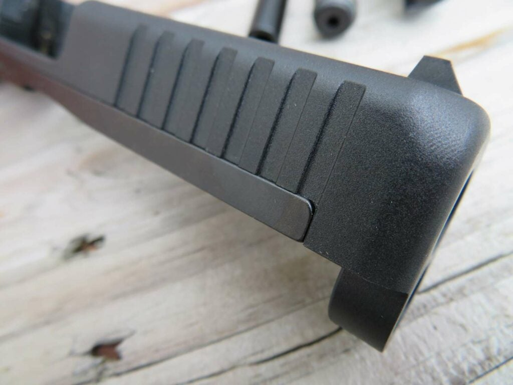 Polymer and steel construction of the Glock 44 slide.