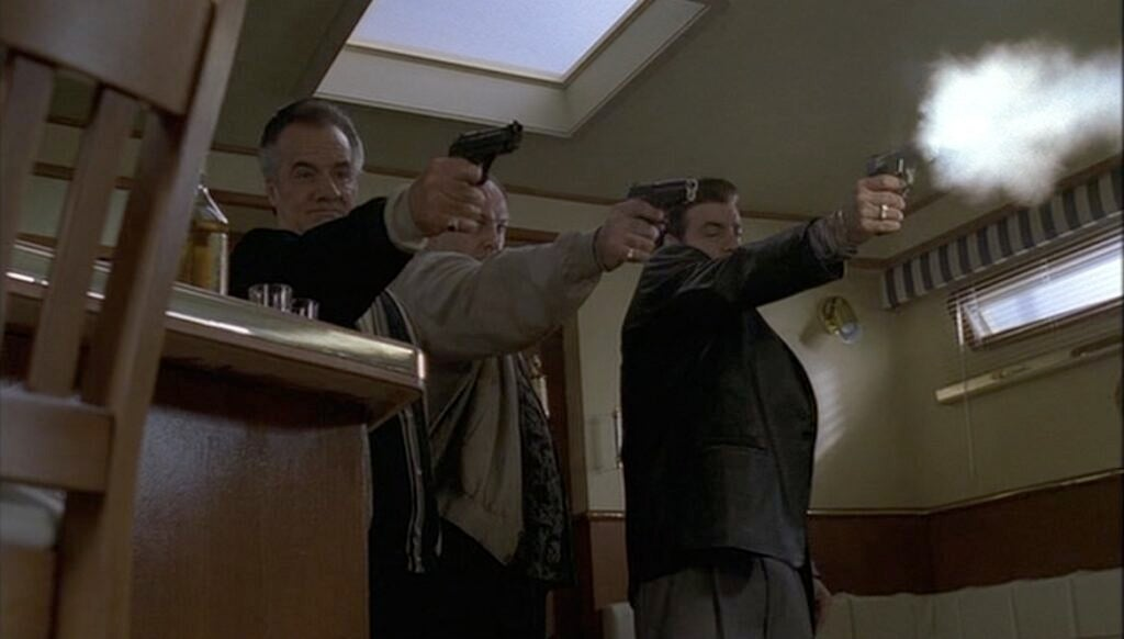 Paulie, Tony, and Sil open up on Puss with three different handguns.
