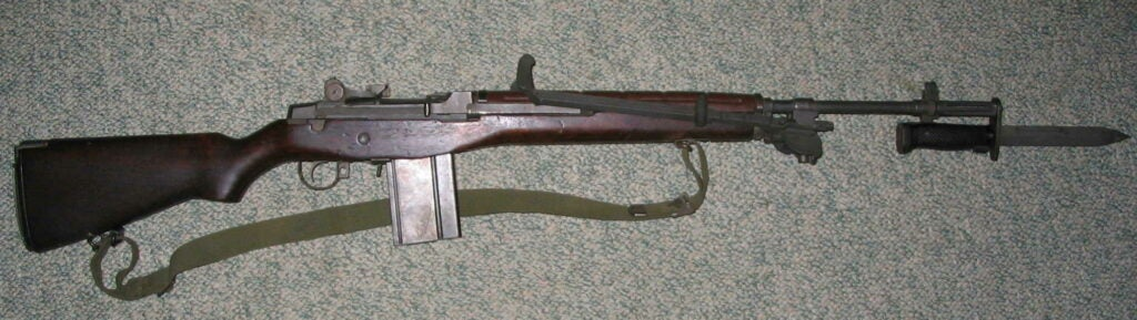 An early M1A rifle from Springfield Armory with a bipod and an M6 bayonet attached.