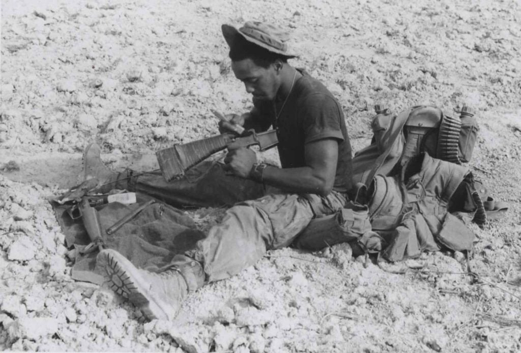 Marine cleaning an M16 in Vietnam.