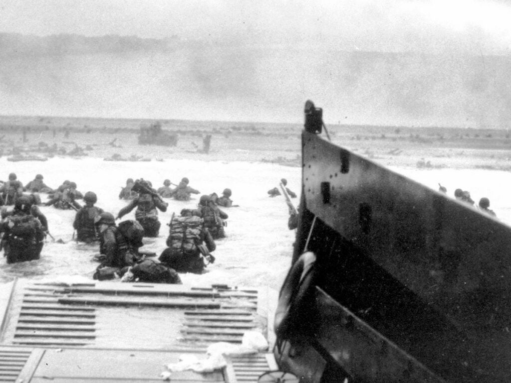 Soldiers storming the beaches of Normandy on D-Day.