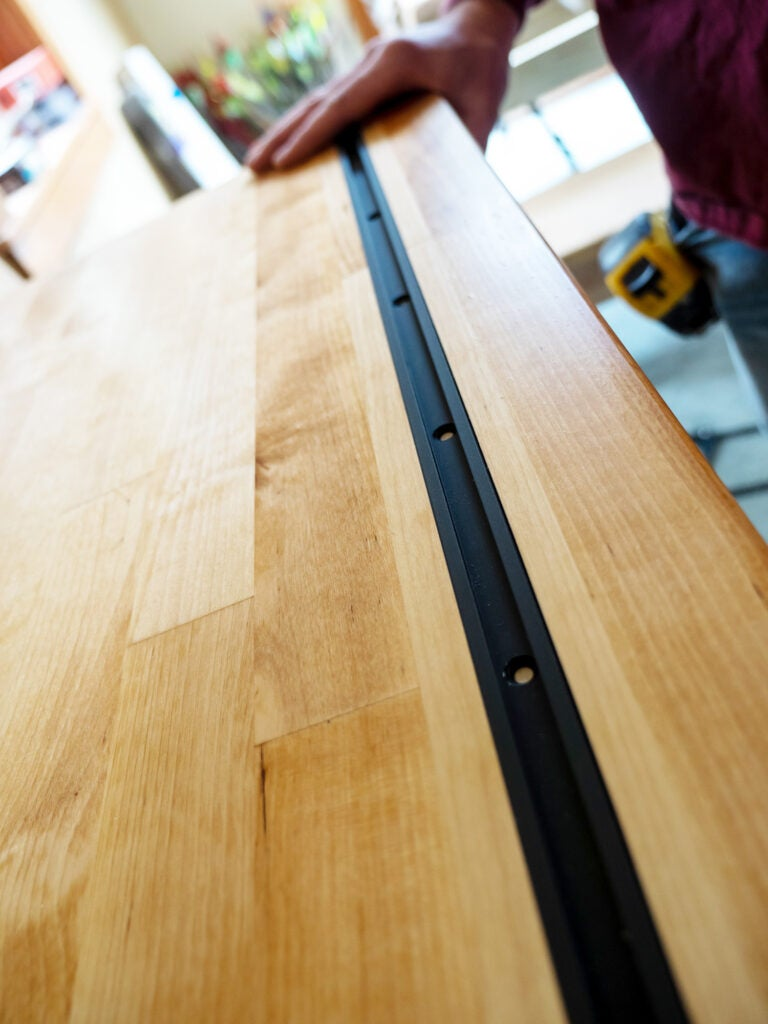 Four 48-inch universal t-tracks were installed with the #6 screws.
