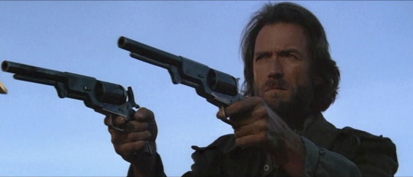 """Clint Eastwood famously used a pair of monstrous reproduction Colt Walker revolvers in <i> The Outlaw Josey Whales</i>."""" class=""""wp-image-1590″/><figcaption>Clint Eastwood famously used a pair of monstrous reproduction Colt Walker revolvers in <i> The Outlaw Josey Whales</i>. <i>imfdb.org</i></figcaption></figure>  <p id="""