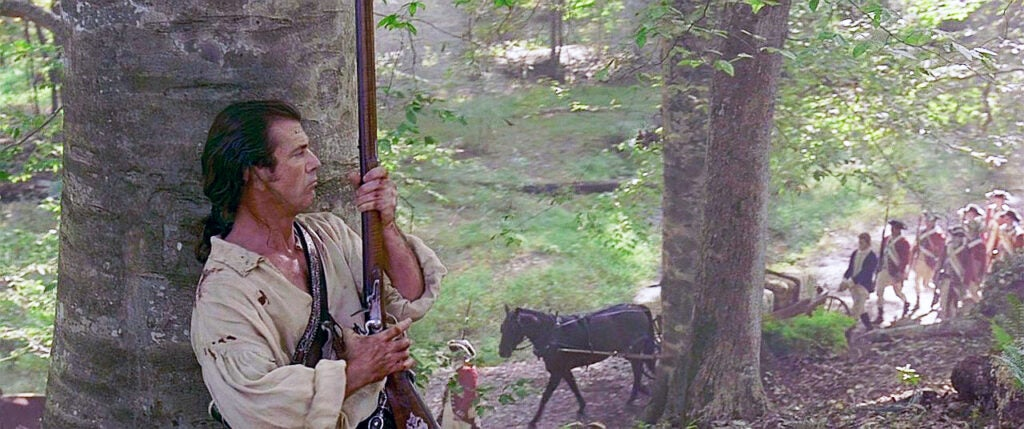"""Though <i>The Patriot</i>(2000) was largely fantastical, the Kentucky Long Rifle used by main character Benjamin Martin was period accurate and made for Mel Gibson by artist Frank House, who trained several actors to use the flintlocks."""" class=""""wp-image-1587″/><figcaption>Though <i>The Patriot</i>(2000) was largely fantastical, the Kentucky Long Rifle used by main character Benjamin Martin was period accurate and made for Mel Gibson by artist Frank House, who trained several actors to use the flintlocks. <i>imfdb.org</i></figcaption></figure>  <p id="""