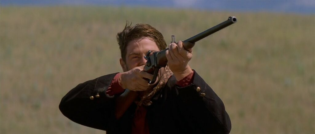 """A Sharps carbine being fired by a U.S. calvary soldier in <i>Dances With Wolves</i>."""" class=""""wp-image-1597″/><figcaption>A Sharps carbine being fired by a U.S. calvary soldier in <i>Dances With Wolves</i>. <i>imfdb.org</i></figcaption></figure>  <p id="""