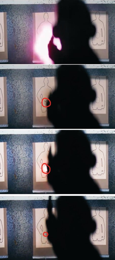 Here's some movie magic for you: When Harry is shooting at the target and the camera is over his shoulder, it looks pretty convincing that he's actually punching holes in paper. But actually, there are squibs in the target set to go off a fraction of a second after each shot is fired. But on his fourth shot, there's a small delay and the squib causes the paper target to flare a little bit. You can only catch it if you watch it frame by frame: top frame is Harry firing a blank; the second frame is after the shot has been fired and there's no hole in the target; the third frame shows the squib ignite to create the hole in the target just as Harry's gun rises with recoil; the last frame shows the new hole in the target created by the squib.