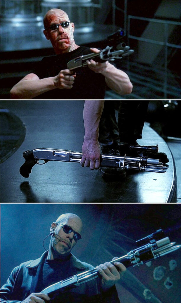 Reinhardt (Ron Perlman) uses a Remington 870 Marine Magnum with launchers that fire silver spikes, similar to the Benelli Blade uses in the first movie.